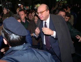 Mani pulite - Bettino Craxi, viewed by many as the symbol of Tangentopoli, leader of the Italian Socialist Party, is greeted by a salvo of coins as a sign of loathing by protesters contesting him.