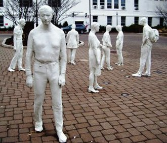 George Segal (artist) - Segal's Street Crossing (1992), located at Montclair State University, is typical of the look of his sculptures