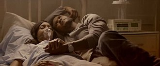 "Numb (Usher song) - Usher lying together with a sick woman in a hospital in the video for ""Numb""."