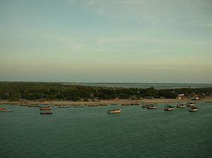 Pamban Island - Fishing schooners leaving for an evening haul with a narrow promontory on the western tip of Pamban Island in the background