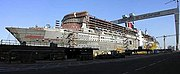Queen Mary 2 under construction, her radar mast in the right foreground