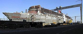 RMS Queen Mary 2 - Queen Mary 2 under construction, her radar mast in the right foreground