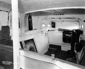 Motor Torpedo Boat PT-109 - PT tankroom below deck, looking forward, shows exposed fuel tank on left.