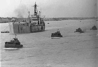 USS Tom Green County (LST-1159) - USS Tom Green County (LST-1159) operating in the Mekong River, circa 1968.