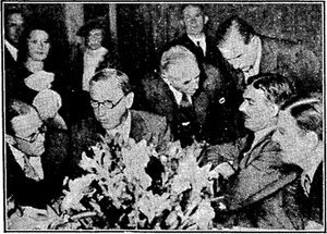 "Nyon Conference - An ""informal picture"" published in The Times of members of the British delegation. Anthony Eden sits to the right, accompanied by Lord Chatfield and Sir Robert Vansittart."
