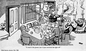 "Giles family - The Giles Family in ""Power Cut"", Daily Express (January 15, 1963). Clockwise from the left: Ernie, Bridget, George Jr, Vera, Mother, Father, Grandma, Carol, Ann and the twins, plus dogs under the table and cat behind Grandma's chair. Missing are George and the parrot."