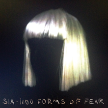 "A blonde bobbed wig against a black background. Stylised along the bottom of the image are the words ""Sia"", and ""1000 Forms of Fear""."