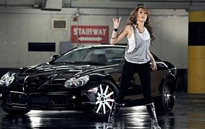 "Fly on the Wall (song) - Cyrus beside her car while trying to hide from the paparazzi in the ""Fly on the Wall"" music video. The video, particularly Cyrus' attempted escape from the paparazzi, was inspired by Michael Jackson's Thriller."