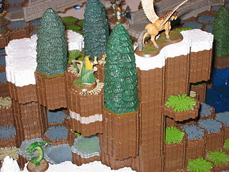 Heroscape - Syvarris and Theracus command the high ground in a snowy forest atop the mountains.