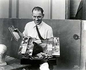 "Lon Chaney - Lon Chaney in 1925, during the filming of The Phantom of the Opera, showing his famous makeup case that he used to transform himself into ""The Man of a Thousand Faces"""