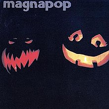 "A photograph of two Jack O'Lanterns—the one to the left with jagged teeth and a furrowed brow, the other with a smile and large doe eyes—on a dark background with the word ""magnapop"" written in blue along the top left corner."