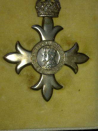 "Order of the British Empire - Close-up of an MBE from 1945 showing the ""For God and the Empire"""