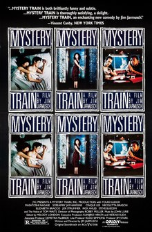 A young Japanese couple are sitting on a dimly-lit street outside a restaurant with a neon sign. The woman is looking off camera and resting against the man, who is downcast with a cigarette in his mouth; both are wearing bright red lipstick. Superimposed above the couple is the title MYSTERY TRAIN, with credits in French below the image.