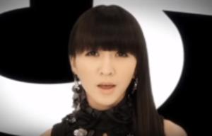 "575 (song) - Perfume member, Kashiyuka, singing in the music video for ""575""."