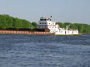 M/V Bill Berry of the Ingram Barge Company pus...