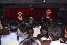 Trixie's Big Red Motorbike live in Osaka, Japan, July 2012.jpg