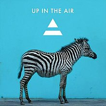 A zebra shown before a blue background, with the song's name and the band's logo shown above