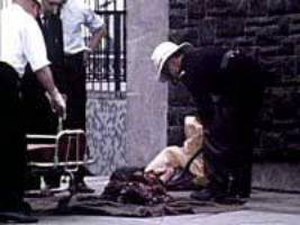 Bloody Friday (1972) - Aftermath of the Oxford Street bomb showing the remains of one of the victims being shovelled into a bag