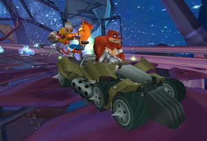 """Crash Tag Team Racing - Crash and Crunch Bandicoot in a """"clashed vehicle"""" (two cars merged into one), with Crunch at the wheel and Crash in a rotatable turret"""