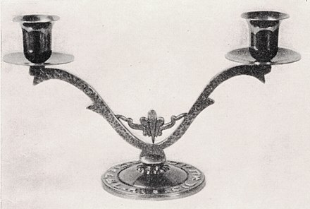 A bronze Shabbat candlestick holder made in British Mandate Palestine in the 1940s. Maurice Ascalon Shabbat Candle Sticks.jpg