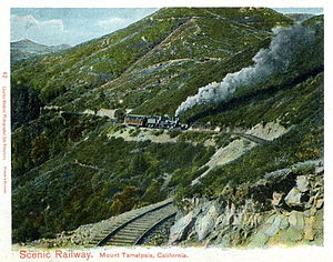 Mount Tamalpais and Muir Woods Railway - In this postcard image, one of the railroad's Shay locomotives works its way up Mount Tamalpais. Note the railroad's practice of pushing trains upgrade, with the engine reversed at the rear of the train.