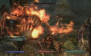 Screenshot from The Elder Scrolls V: Skyrim: player character using magic fire against giant spiders.