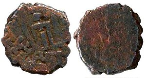 "Coin of Sodasa, satrap of Mathura, AE. Obv: Lakshmi standing between two symbols on the obverse and inscription around ""Mahakhatapasa putasa Khatapasa Sodasasa "". Rev: Standing Abhiseka Lakshmi anointed by two elephants (Blurred)"