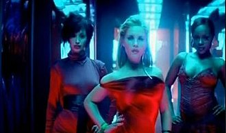 """Red Dress (song) - Amelle Berrabah, Heidi Range and Keisha Buchanan wearing red dresses in the music video for """"Red Dress""""."""