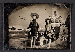 Tintype - Tintype of two girls in front of a painted background of the Cliff House and Seal Rocks in San Francisco, circa 1900