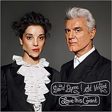 The cover of Love This Giant: The musicians facing the camera and wearing black formal attire with jagged deformities on their faces