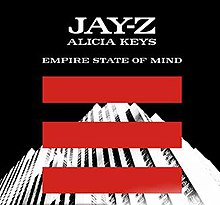 "An image of a white building shown at a slanted angle with three red lines coming across the image of the building. The words ""Jay-Z"", ""Alicia Keys"" and ""Empire State of Mind"" written in capital letters overlapping a black background can also be seen."