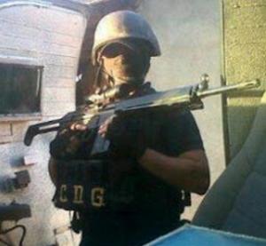 Héctor David Delgado Santiago - Héctor David Delgado Santiago holding a G3 rifle