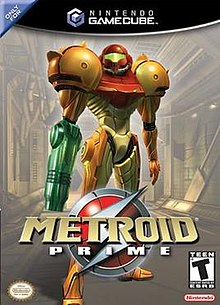 "A person in a big, futuristic-looking powered suit with a helmet, a firearm on the right arm and large, bulky, and rounded shoulders, stands on an industrial-like corridor. Atop the image is the Nintendo GameCube logo, and the text ""Only for"" in the upper left corner. In the bottom of the image, the title ""Metroid Prime"" in front of an insignia with a stylized ""S"", the Official Nintendo Seal of Quality, Nintendo's logo, and ESRB's rating of ""T""."