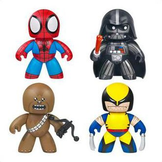 Mighty Muggs - Four figures from the Mighty Muggs line. Clockwise from top-right: Darth Vader, Wolverine, Chewbacca, and Spider-Man