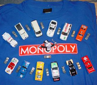 History of the board game Monopoly - Twelve Johnny Lightning model cars bearing Monopoly artwork, and a 13th game token, resting on a Monopoly T-shirt