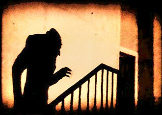 Nosferatu - An iconic scene of the shadow of Count Orlok climbing up a staircase