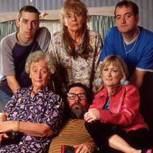 "The Royle Family -  From left to right, Ralf Little as Antony Royle, Liz Smith as Norma Speakman (Nana),  Sue Johnston as Barbara Royle,  Ricky Tomlinson as James ""Jim"" Royle, Caroline Aherne as Denise Best (née Royle), Craig Cash as Dave Best"
