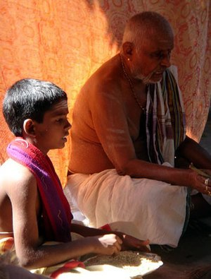 Iyer - Iyer priest from Tamil Nadu carrying out a small ritual with his grandson.