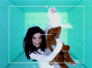 Violently Happy - In a scene of the music video, Björk removes the innards from a teddy bear