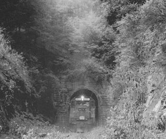 North Bend Rail Trail - A CSX work train emerges from the east portal of the 1,086-foot tunnel No. 2 near Salem on September 9, 1988. Tracks are being removed west of the tunnel.