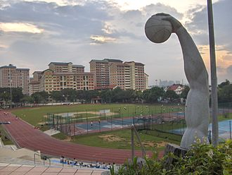 Catholic High School, Singapore - Catholic High track and field, with basketball sculpture in foreground