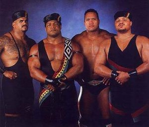 "Nation of Domination - The late 1997/early 1998 incarnation of the Nation, from left to right: Kama Mustafa, Faarooq, The Rock, and D'Lo Brown. Motto: ""By Any Means Necessary"""