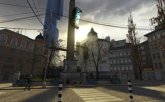 "Locations of Half-Life - The Trainstation Plaza in City 17, with propaganda being broadcast from one of many ""Breencast"" screens in the city. The Citadel is visible in the background."