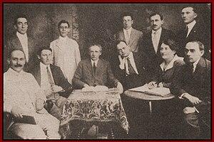 Jewish Socialist Federation - Leadership of the Jewish Socialist Federation in 1917.  Seated (L-R): Ben-Tsien Hofman (Tsivion), Max Goldfarb, Morris Winchevsky, A. Litvak, Hannah Salutsky, Moishe Terman.  Standing: Shauchno Epstein, Frank Rozenblat, Baruch Charney Vladeck, Moissaye Olgin, Jacob Salutsky (J.B.S. Hardman).