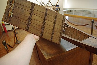 Khufu ship - Model of the solar barge with the deck removed, showing the rope stitching that holds the planks together.
