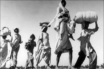 Old-sikh-man-carrying-wife1947