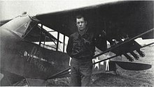 Picture of a man standing in front of a light aircraft