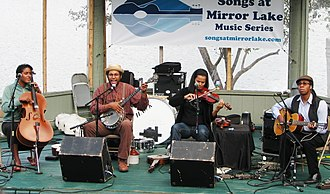 Carolina Chocolate Drops - Carolina Chocolate Drops at Lake Placid, New York. Left to right: Leyla McCalla, Dom Flemons, Rhiannon Giddens, Hubby Jenkins