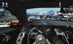 Forza Motorsport 4 - Forza Motorsport 4 features a cockpit view for increased realism. The driver's arms are animated in sync with player controls.
