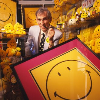 Harvey Ball - Ball posing with a selection of Smiley merchandising
